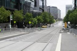 Additional pedestrian crossing provided at the other end of the Batman's Hill tram stop on Collins Street