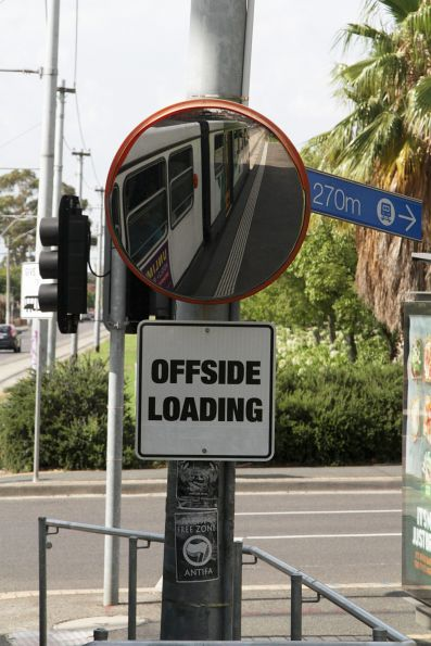 'Offside Loading' notice at a tram stop on St Georges Road