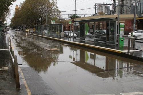 Floodwaters cover the tram tracks at Flinders and Market Streets