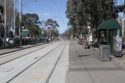 Tram stop on the reserved track at Sydney Road and Brunswick Road