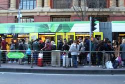 Overcrowded westbound tram stop at Bourke and Spencer Street