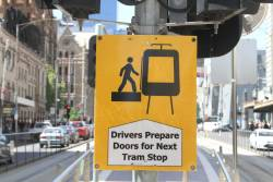 'Drivers prepare doors for next tram stop' notice at the 'offside' stop at Flinders and Swanston Street