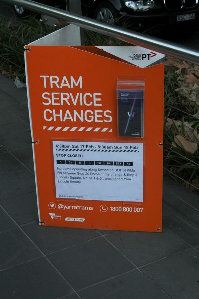 Tram service changes for White Night poster at a St Kilda Road tram stop