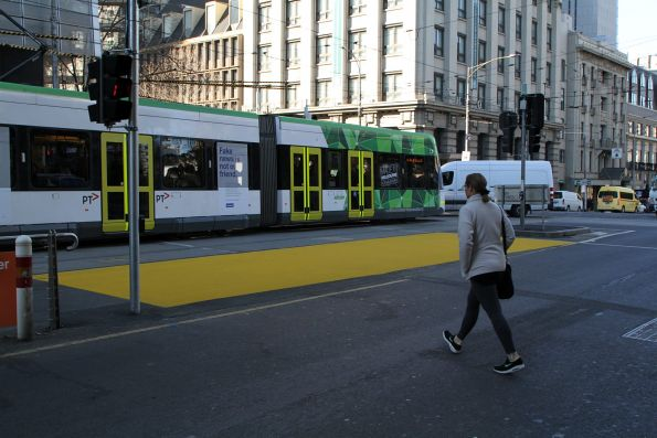 Waiting zone between road and tram tracks painted yellow outside Southern Cross Station