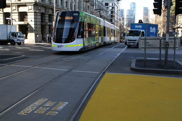 You'd think the yellow indicates a safe place to stand, but if you do, you'd get hit by a passing tram!