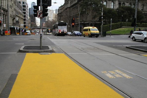 Yellow non-slip paint applied to the pedestrian crossing at Spencer and Collins Street