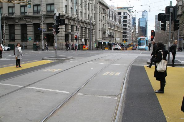 Yellow non-slip paint cut back at the pedestrian crossing at Spencer and Collins Street