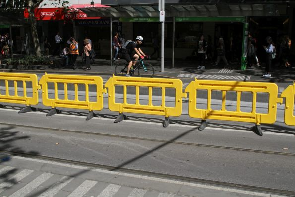 New but temporary fencing between the two tracks at the Swanston and Collins Street tram stop