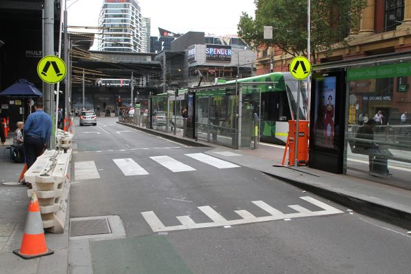 The additional pedestrian crossing to the Bourke and Spencer Street tram stop finally open!