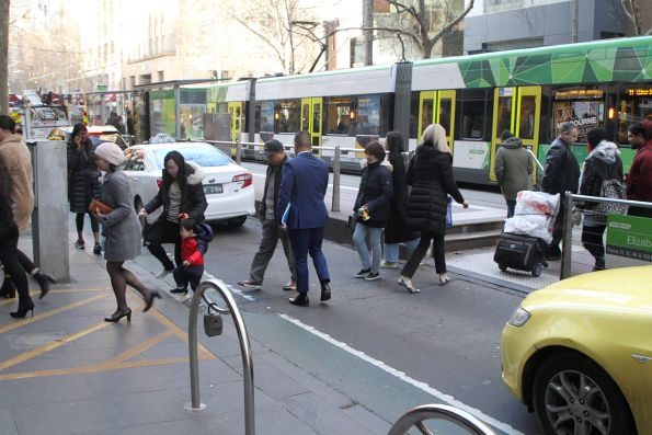 Ad hoc pedestrian crossing at the west end of the Collins and Elizabeth Street tram stop