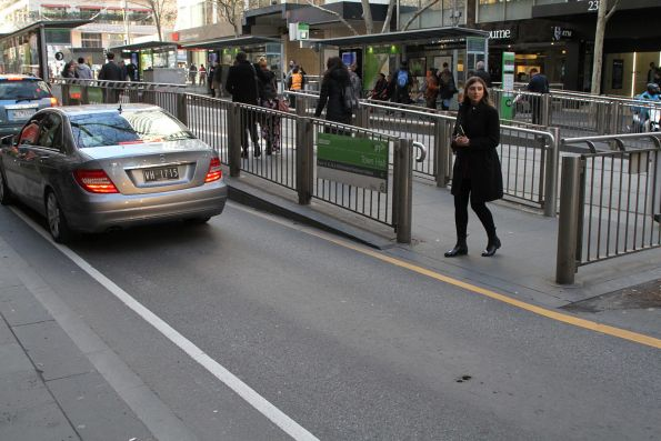 Ad hoc pedestrian crossing at the west end of the Swanston and Elizabeth Street tram stop