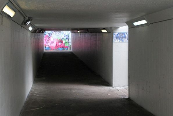 Dark and dingy tram stop underpass at St Kilda Junction