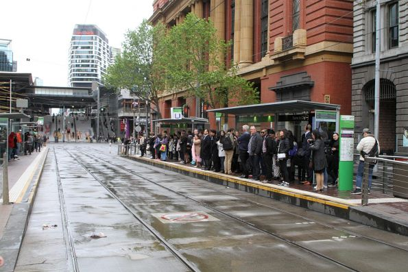 Crowd of passengers waiting for the next eastbound tram at Bourke and Spencer Street