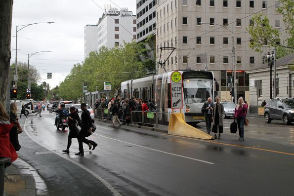 Flagstaff station tram stop at William and La Trobe Street overflowing with passengers