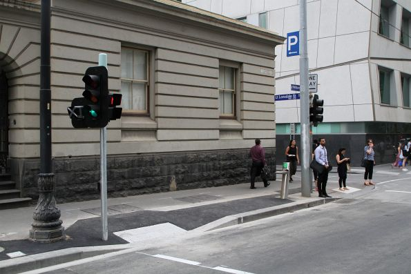 Widened pedestrian crossing leading to the new Flagstaff station platform stop at William and La Trobe Street
