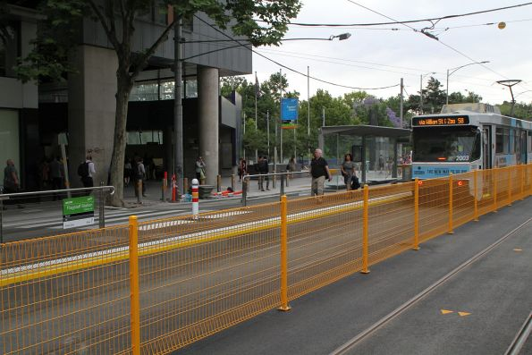 Big fence between the tram stop platforms at William and La Trobe Street
