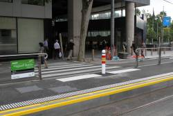 Mid block pedestrian crossing between Flagstaff station and the northbound platform stop at William and La Trobe Street