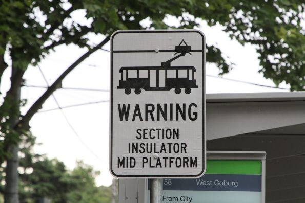 'WARNING section insulator mid platform' sign at the new William and La Trobe Street tram stop