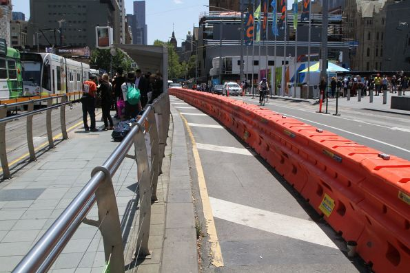 Crash barriers protect an additional walkway behind the southbound Federation Square tram stop