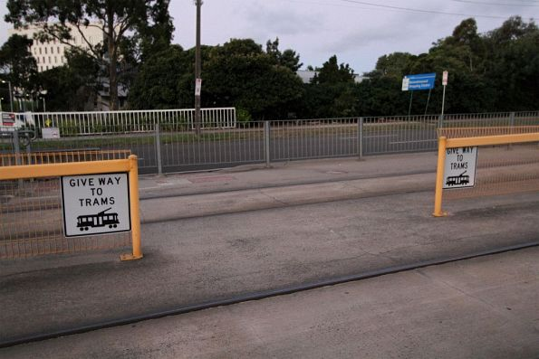 Pedestrian crossing links the citybound and outbound platforms at the Deakin University tram stop