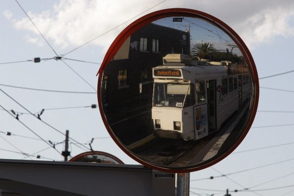 Z3 tram reflected in the rear view mirror at a platform stop