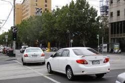 Newish hook turn indicator signals at the corner of William and La Trobe Streets