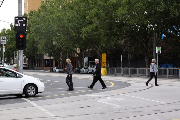 'Stop' line painted on the road for hook turns at the corner of William and La Trobe Streets