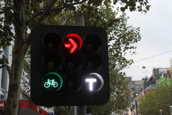 Traffic lights on the approach to the new Melbourne Central tram stop, with three movements: bike, right turn and tram