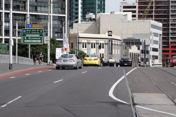 That's rather pointless: making room for a bus lane by putting cars into the tram lane