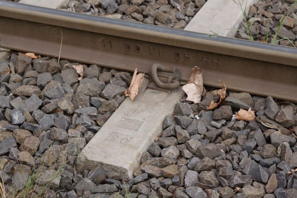 'YT' imprinted in the concrete sleepers used by Yarra Trams