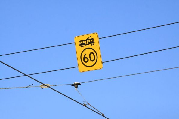 60 km/h speed limit sign above the overhead on Flemington Road