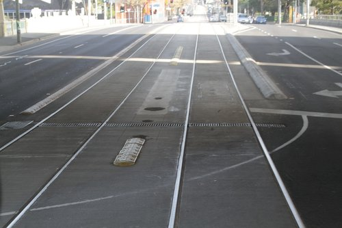 Bollards removed from between the tram tracks at the corner of Racecourse Road and CityLink