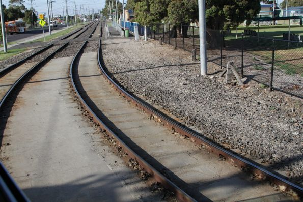 Reserved track on route 82 with concrete poured around the sleepers