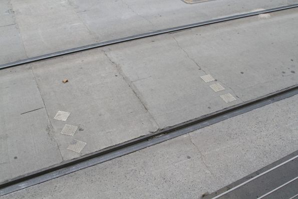 Three diamonds indicate the stopping point for E class trams, three squares mark where all other trams stop