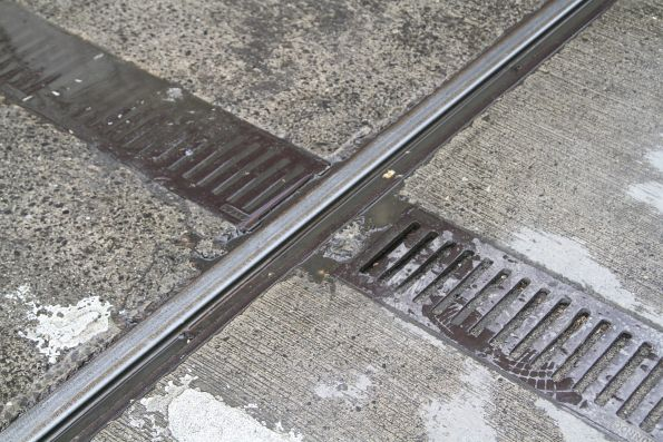 Clogged track drains at Collins and Elizabeth Street