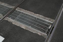 New style track drainage grills at Bourke and William Street