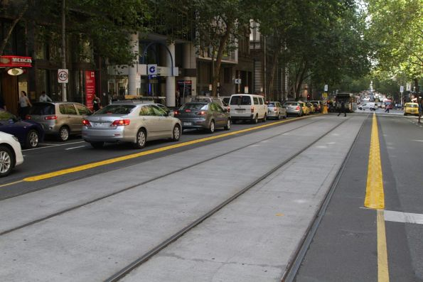 Yellow plastic kerbing in place along the Collins Street tram tracks