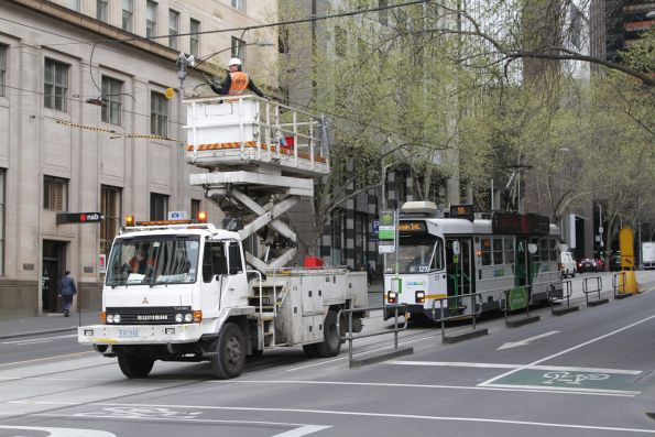 Z3.127 on a route 55 service waits as the overhead lines at William and Collins Street are repaired