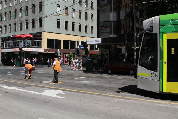Tramway staff work to repair a defective set of automatic points at the Elizabeth Street terminus