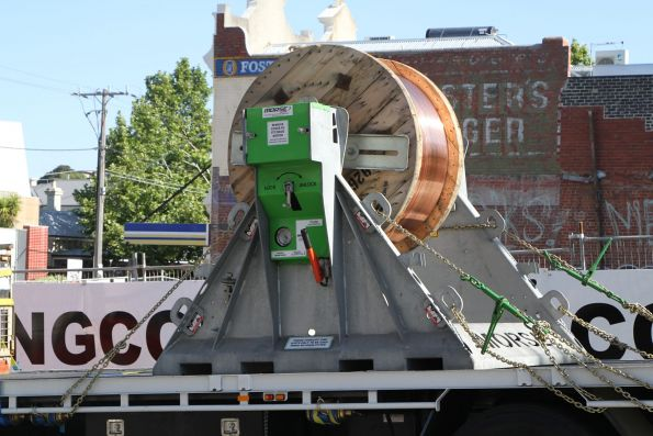 Truck loaded with a drum of copper wire for the tramway overhead