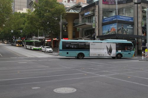 With poles either side of Elizabeth Street blocking his route, the driver needs to reverse