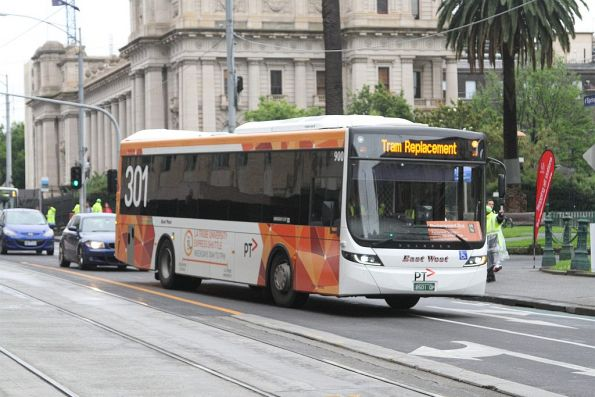 East West bus #900 BS01QP at Spring and Collins Street