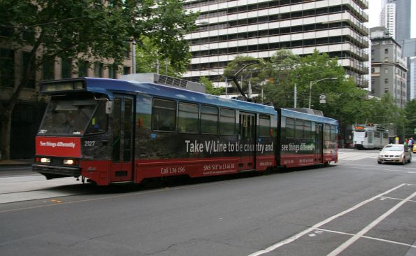 B2.2127 advertising V/Line northbound on route 55 on William Street at Collins