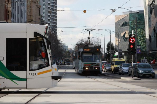 D1.3518 heads along Swanston Street, A2.271 waiting for the traffic lights on Flinders Street