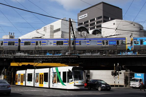 D2.5002 passes under the Viaduct at Flinders and Spencer Streets, Comeng 385M-561M passes overhead