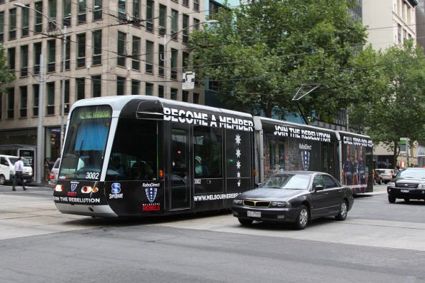 C.3002 advertising 'Melbourne Rebels' westbound at Collins and William Streets