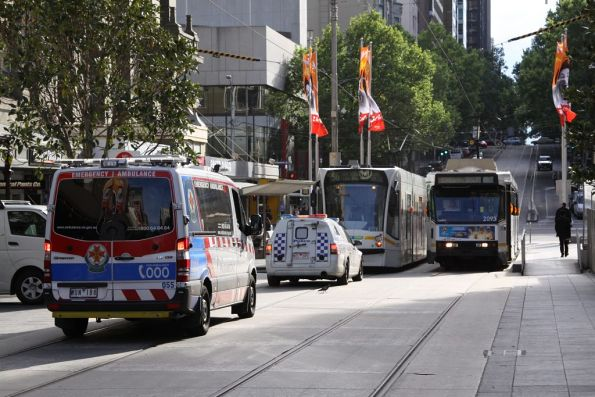 Divvy van and ambulance waiting on trams in the Bourke Street Mall