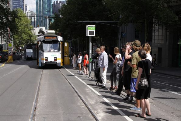 Z3.165 stops for passengers on William Street, at the Collins Street stop on route 55 northbound