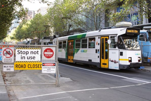 Z class trams beside the works for the new platform stop on Swanston Street at Bourke