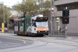 A1.239 waits to turn from Spencer into La Trobe Street with a route 95 service